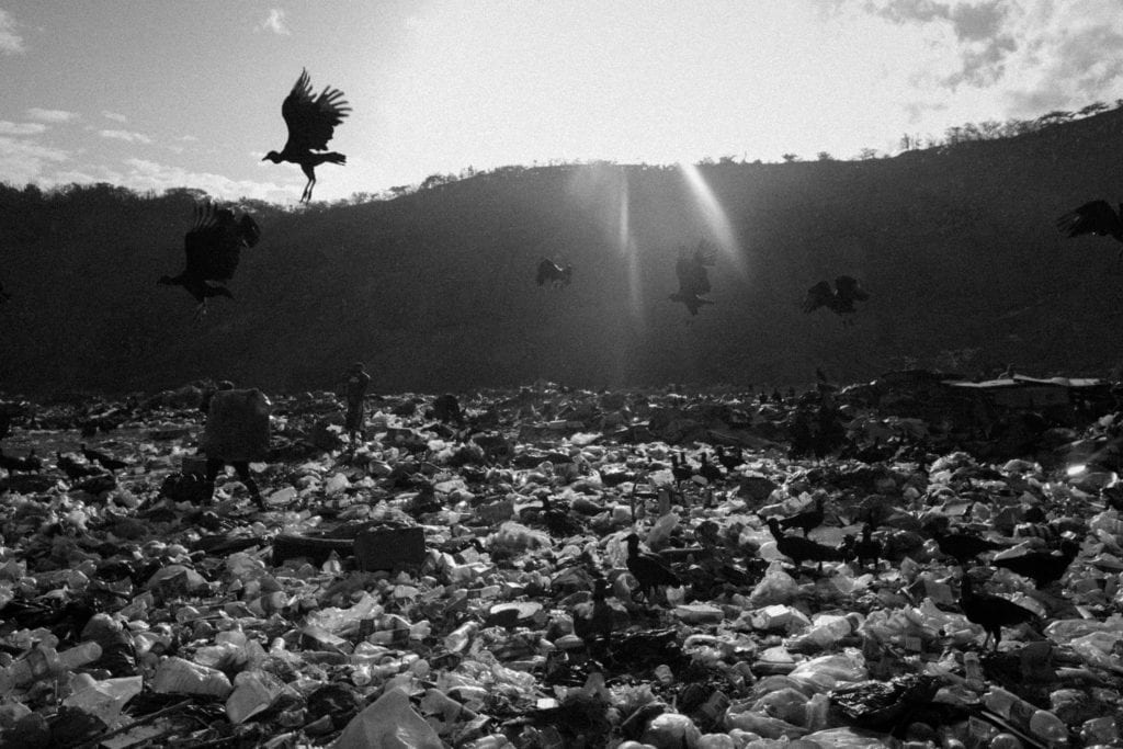 A garbage dump located in the outskirts of Caracas on July 6, 2016, where the families looking for food have increase in the past year do to the severe economic crisis and food shortage. From the series Blurred in Despair.