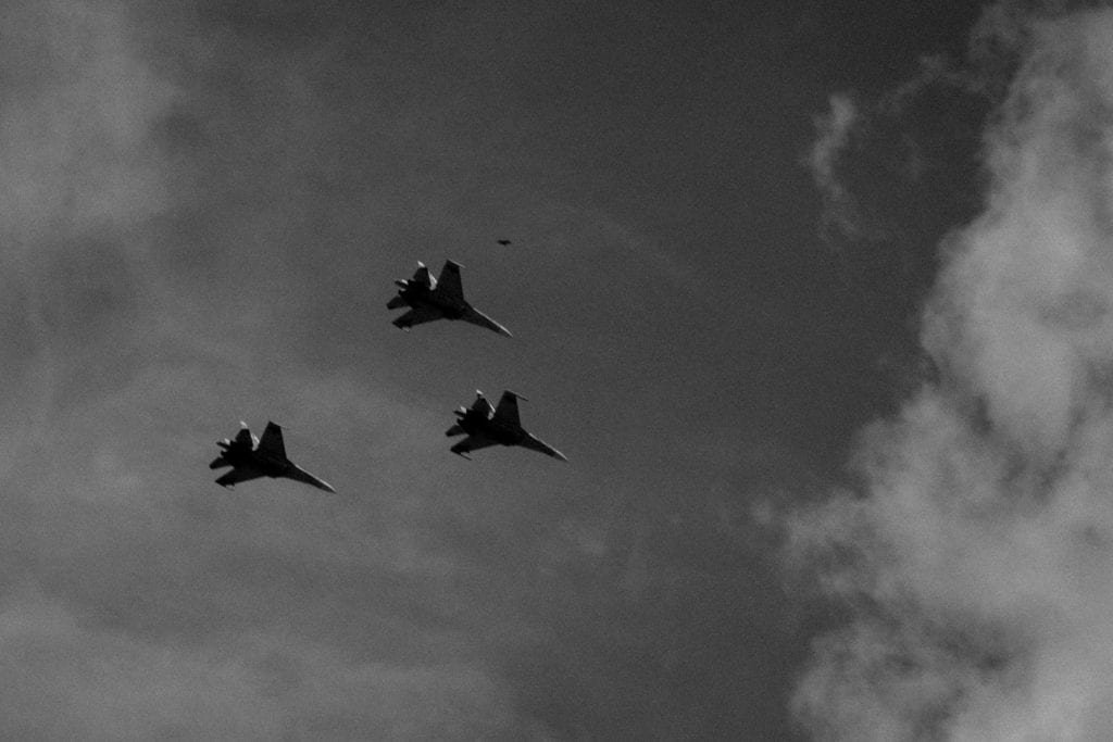 Three air force planes fly around Caracas during the celebration of the Venezuelan Idependence Day on July 5th military parade. While the east part of the city lived almost daily riots, the President Nicolás Maduro makes TV transmisions every week to show the support of the armed forces. From the series Blurred in Despair.